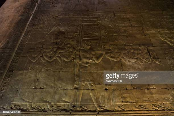 Ruin stone carving god horus and osiris at edfu temple near nile river egypt