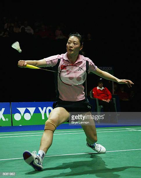 Ruina Gong of China in action during the Yonex All England Open Badminton Championships at the National Indoor Arena on March 13, 2004 in Birmingham,...