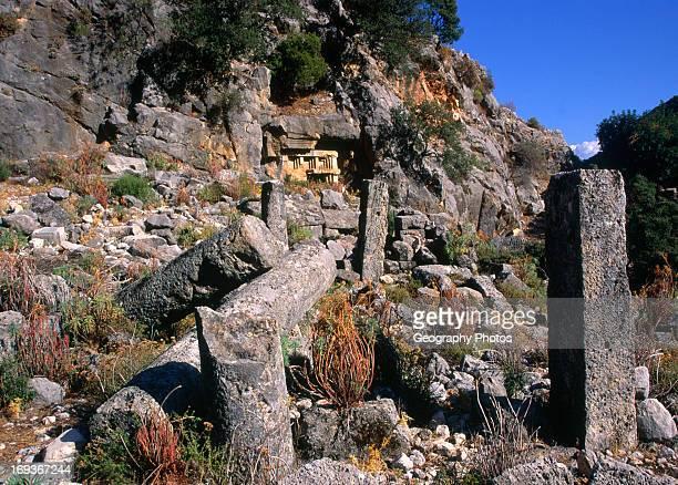 Ruined buildings and rock tomb Lycian city of Pinara Turkey