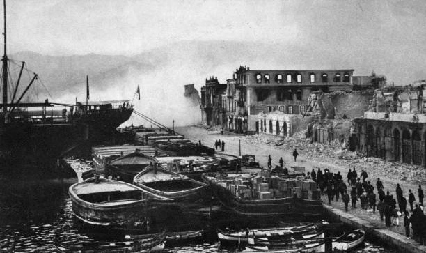 Ruined buildings on the quay at Smyrna are dynamited,...