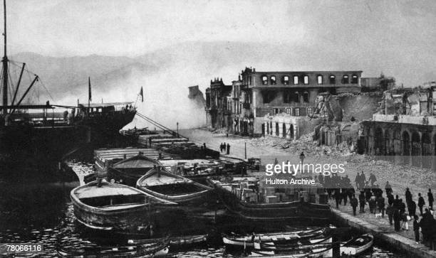Ruined buildings on the quay at Smyrna are dynamited, following their partial destruction in the recent fire, 1922. The fire marked the end of the...