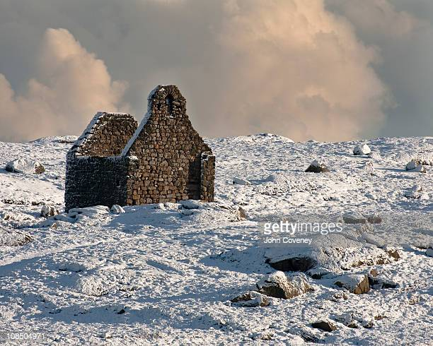 ruined church in snow - dalkey stock pictures, royalty-free photos & images