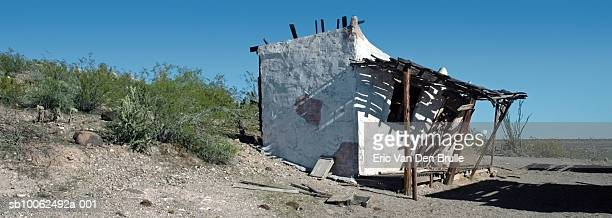 ruined house in desert - eric van den brulle stockfoto's en -beelden