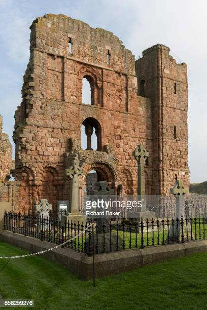 Ruined sandstone wall of the early 12th century Lindisfarne Priory, on 27th September 2017, on Lindisfarne Island, Northumberland, England. The...