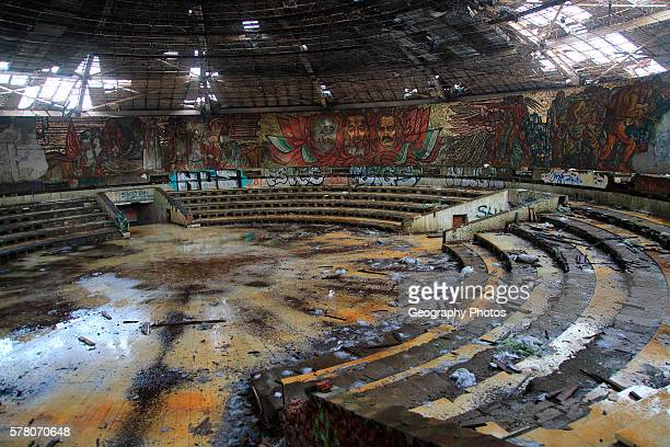 Ruined vandalized interior of Buzludzha monument former communist party headquarters Bulgaria eastern Europe