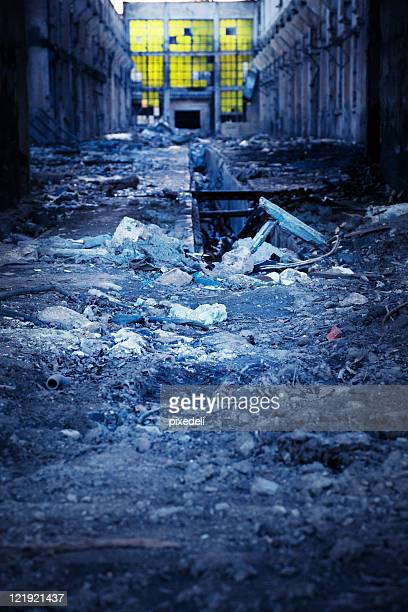 ruined warehouse in the evening - disintegration stock photos and pictures