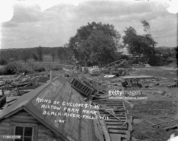 Ruins after a tornado Black River Falls Wisconsin August 7 1924 Demolished farm buildings wagons and a windmill