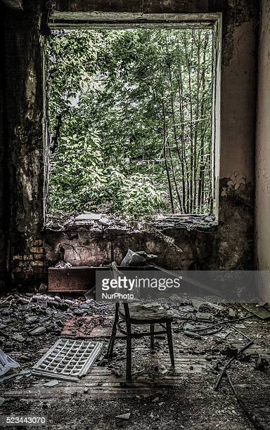Ruins in desolate buildings in Pripyat surrounded by an emerging forest on June 12 2013 The Chernobyl disaster was a catastrophic nuclear accident...