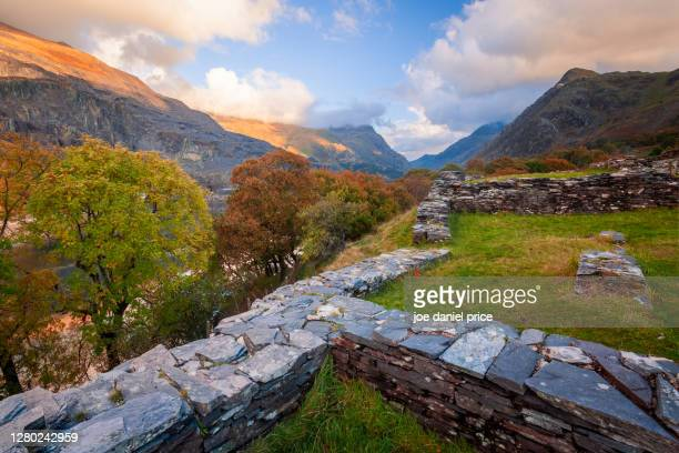 ruins near castle dolbadarn, llyn peris, snowdonia, wales - autumn stock pictures, royalty-free photos & images