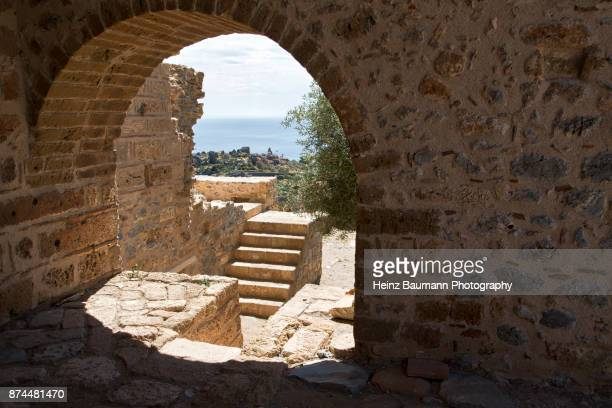 ruins near the byzantine church of agia sophia, monemvasia, peloponnese, greece - heinz baumann photography stock-fotos und bilder