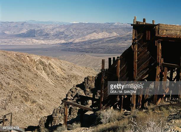 Ruins of a mill for crushing ore to extract gold around the ghost town of Skidoo Death Valley National Park Death Valley Nevada United States of...