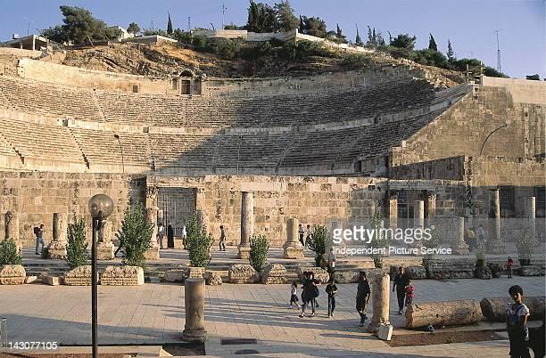 Ruins of a Roman amphitheater in the old city of Amman Jordan The theater was built under Emperor Antoninus Pius