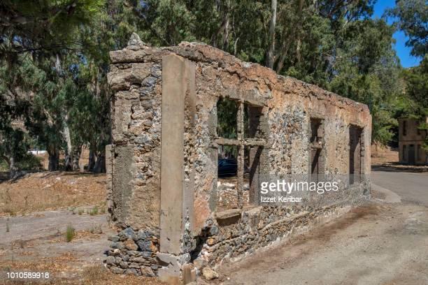 ruins of a stone building probably destroyed in wwii bombings, merikia, leros island, greece - greece wwii stockfoto's en -beelden