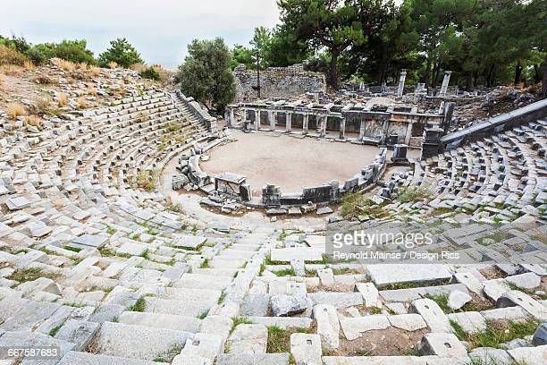 ruins of an amphitheatre - priene stock photos and pictures