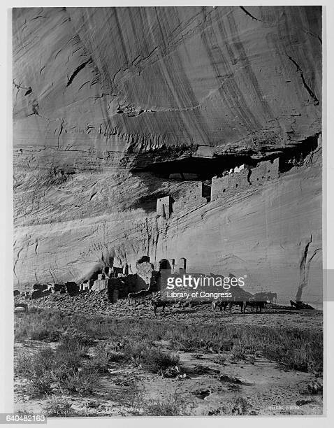 Ruins of an Anasazi and Pueblo settlement cling to the cliffs at Canyon de Chelley. The ruins, inhabited from 350 to 1300, cover a longer period than...