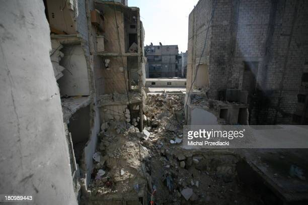 Ruins of an apartment building in Al Fardous district of Aleppo, hit by an aerial bombardment. November 2012, Aleppo, Syria.