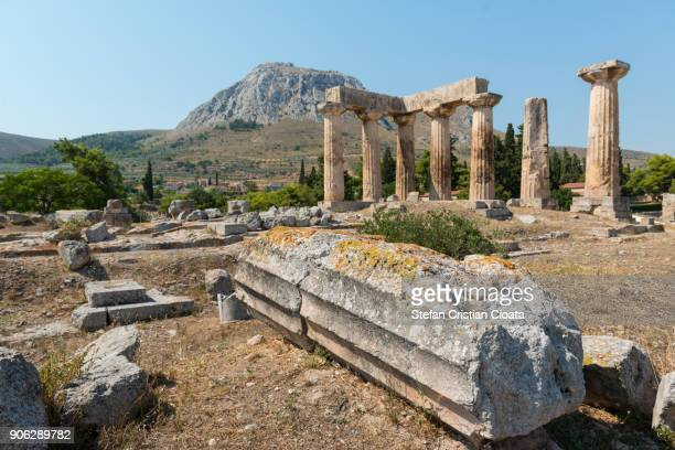 ruins of apollo's temple in corinth greece - oude ruïne stockfoto's en -beelden
