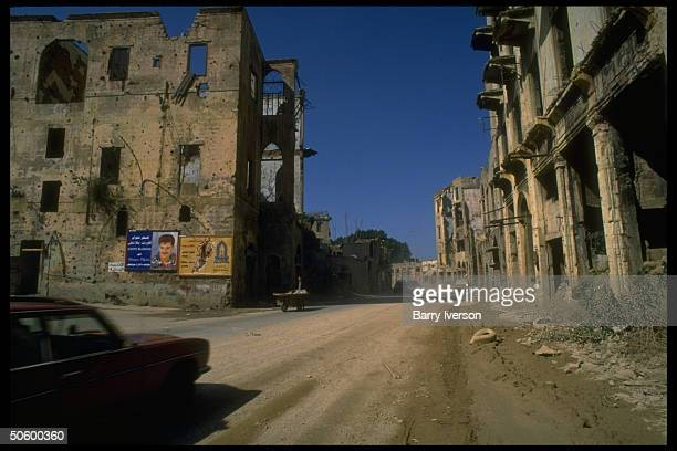 Ruins of bombed out bldgs in port area of city scarred by yrs of civil war