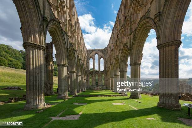 ruins of cistercian abbey in rievaulx destroyed during the dissoluteness of monasteries under henry viii, yorkshire, england, 2018 - antiquities stock pictures, royalty-free photos & images
