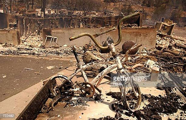 Ruins of destroyed homes in a trailer park caught in the path of the Hayman wildfire burning in the Rocky Mountains southwest of Denver Colorado are...