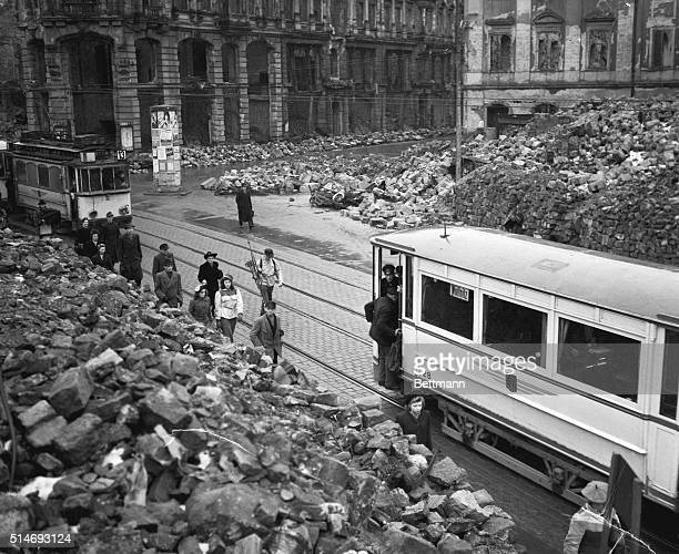 3/16/1946 Ruins of Dresden Germany People step out of a tram car to view the destruction of a entire town the bombing killed more than 135000 people...