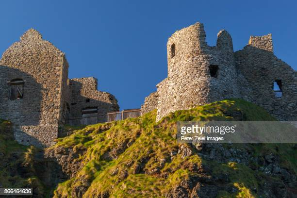 ruins of dunluce castle in northern ireland - dunluce castle stock photos and pictures