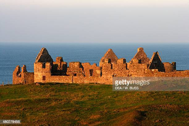 Ruins of Dunluce castle on a cliff overlooking the sea Antrim Northern Ireland United Kingdom