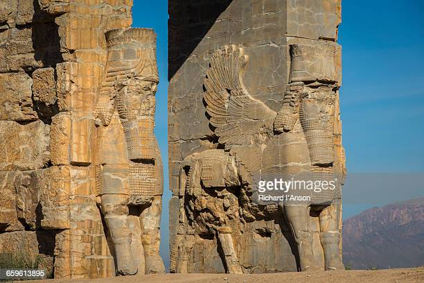 ruins of entry gate at ancient city of persepolis - persepolis stock pictures, royalty-free photos & images