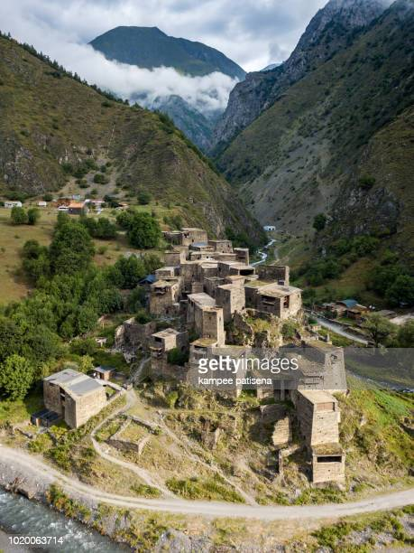 ruins of medieval village-castle shatili. ancient bastions of towers rise above the valley. - georgian culture stock pictures, royalty-free photos & images