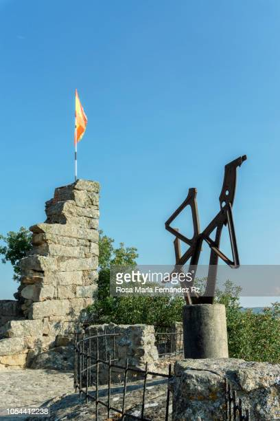 Ruins of old medieval castle  [Doña Urraca Castle),  with spanish flag and iron sculpture, located in Fermoselle, Zamora,  Castilla y León, Spain.