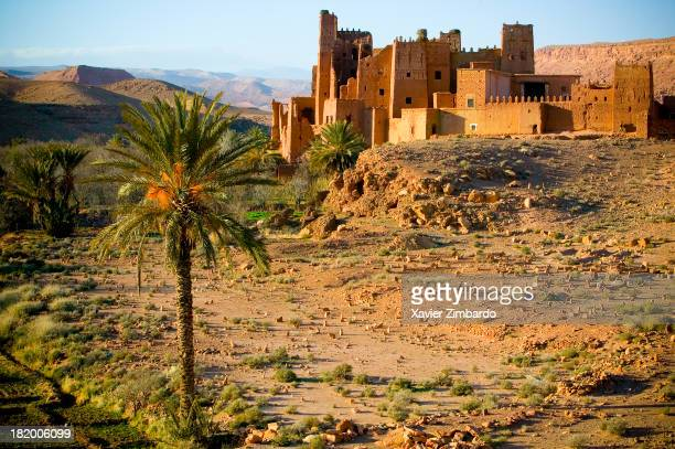 Ruins of one of many Kasbahs along the valley in the Dades Gorge and stone grave markers in a Berber cemetery on February 1 2005 in the Moroccan...