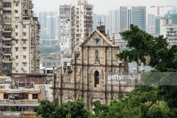 ruins of st paul church and apartment tower in macau - macao stock pictures, royalty-free photos & images
