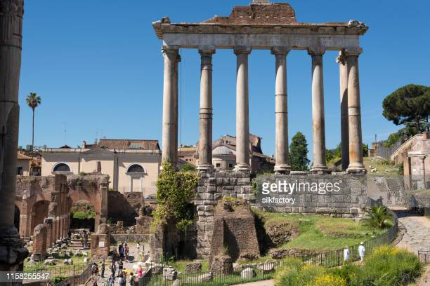 ruins of temple of saturn in roman forum in rome - place of worship stock pictures, royalty-free photos & images
