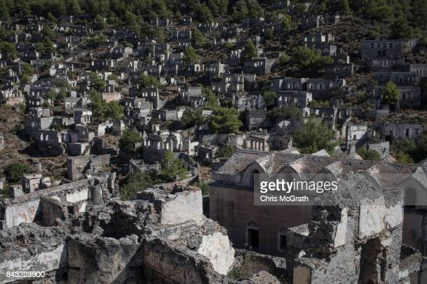 Ruins of the ancient abandoned city of Kayakoy are seen on September 5 2017 in Kayakoy Turkey Turkey's tourism industry spiraled into crisis in 2016...