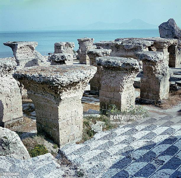 Ruins of the Roman baths at Carthage View of the hypocaust the open space supportedby columns below the floor allowing the passage of hot air and...
