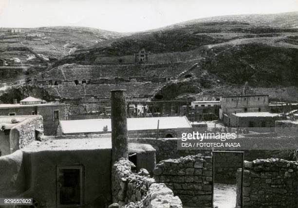 Ruins of the Roman theatre, photo taken from the large colonnaded road, Amman, Jordan, 1928-1930.