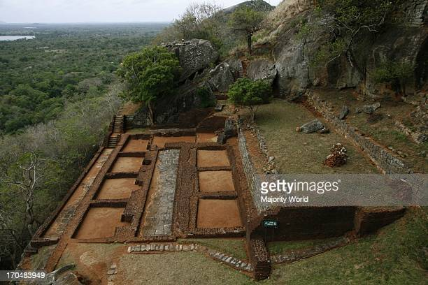 Ruins of the Royal Palace at the top of Sigiriya rock in Matale district of Sri Lanka This 370 meter high lava mound of an ancient volcano is famous...