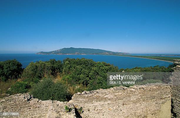 Ruins of the Temple of Jupiter in the Cosa archaeological site 3rd century BC and a view of Argentario island in the background Ansedonia Tuscany...