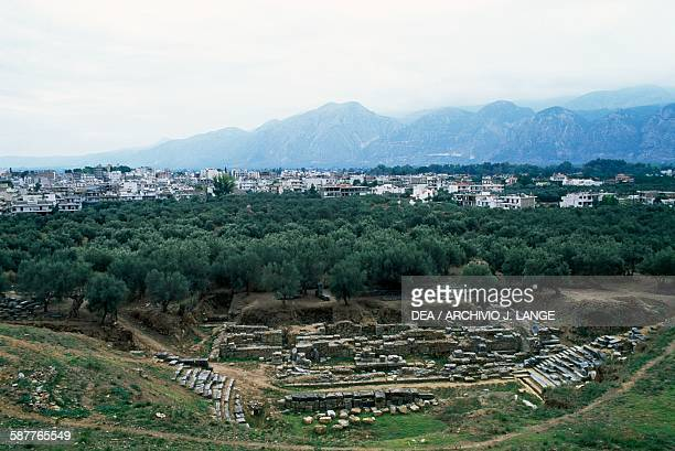 Ruins of the theatre at Sparta with the modern town behind it and Mount Taygetus in the background Peloponnese Greece Roman civilisation 1st century...