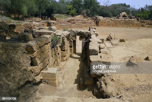 Ruins of the West gate of a Roman amphitheater are pictured 14 August 2002 at the historic site of Tipasa On he Shores of the Mediterranean Tipasa...
