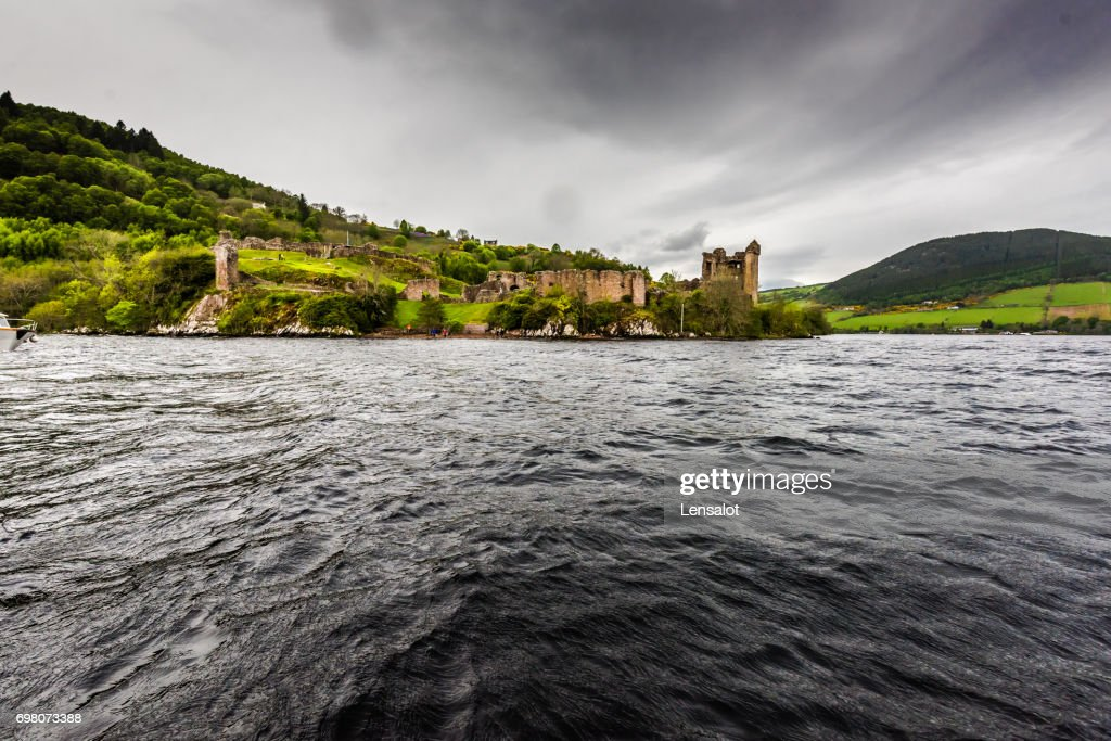 Ruins of Urquhart castle as seen from Loch Ness : Stock Photo
