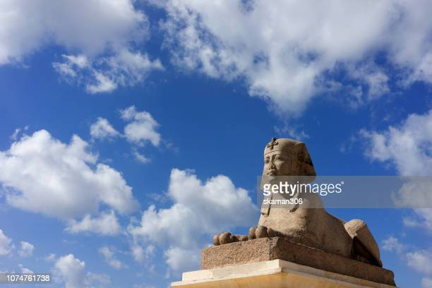ruins sphinx and cloudy day near pompey's pillar  at alexandria city egypt - the sphinx stock pictures, royalty-free photos & images