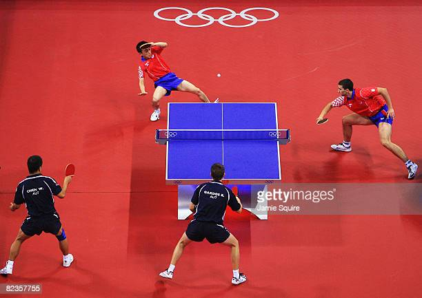Ruiwu Tan and Andrej Gacina of Croatia in action against Robert Gardos and Chen Weixing of Austria during their Men's Team Bronze Playoff Round 1 at...