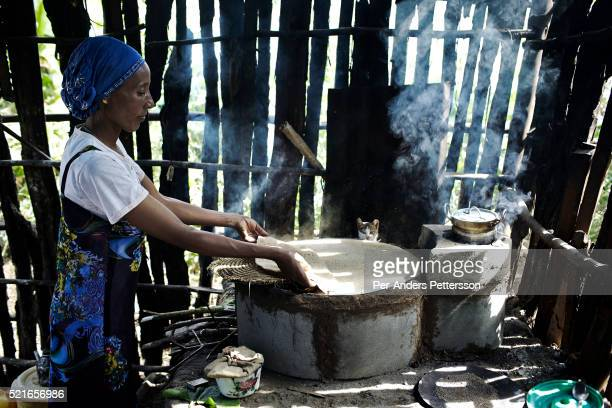 Rukia Mohammed a mother makes Injera on a wood burning stove on December 8 2012 outside Bonga Ethiopia This Kaffa region is known for its coffee...