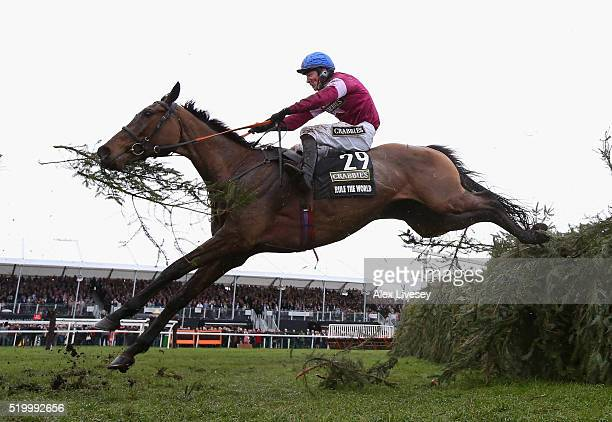 Rule The World ridden by David Mullins clears the last fence on their way to victory in the Crabbie's Grand National Steeple Chase at Aintree...