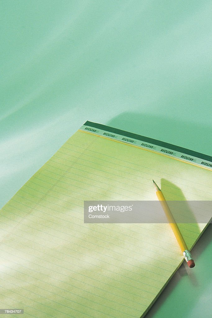Ruled notepad and pencil : Stockfoto