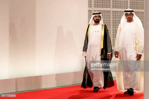 Ruler of Dubai Sheikh Mohammed bin Rashid alMaktoum and Abu Dhabi Crown Prince Mohammed bin Zayed AlNahyan wait for guests at the entrance of the...