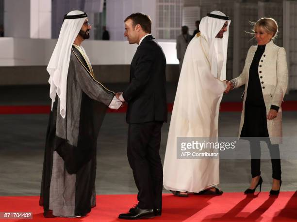 Ruler of Dubai Sheikh Mohammed bin Rashid alMaktoum shakes hands with French President Emmanuel Macron as Abu Dhabi Crown Prince Mohammed bin Zayed...