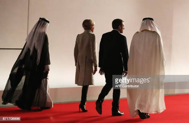 Ruler of Dubai Sheikh Mohammed bin Rashid alMaktoum the French president's wife Brigitte Macron French President Emmanuel Macron and Abu Dhabi Crown...