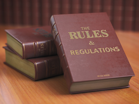 Rules an regulations books with official instructions and directions of organization or team. 1009095456